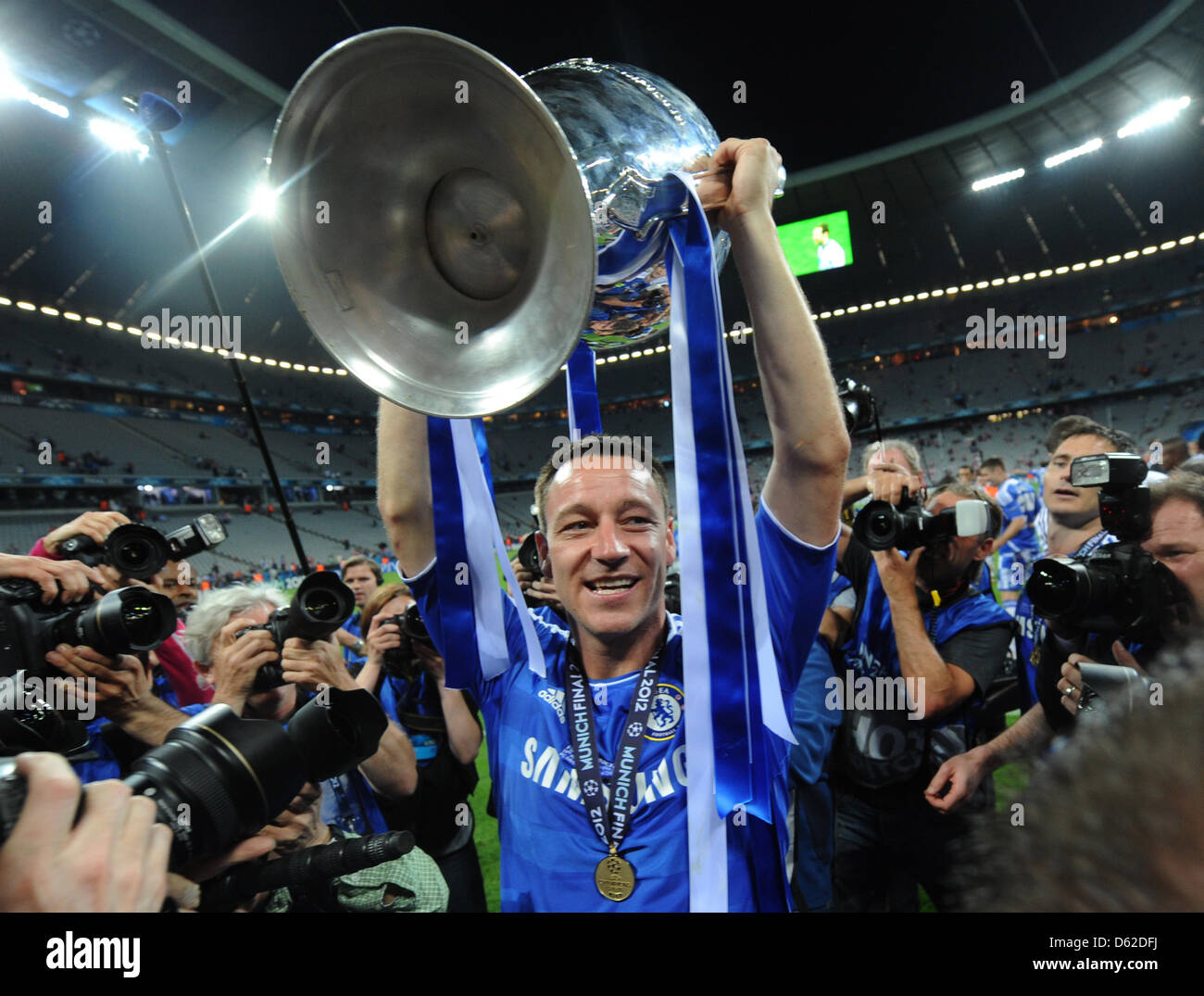 Chelseas John Terry Celebrates With The Trophy After UEFA Champions League Soccer Final Between FC Bayern Munich And Chelsea At Fussball Arena