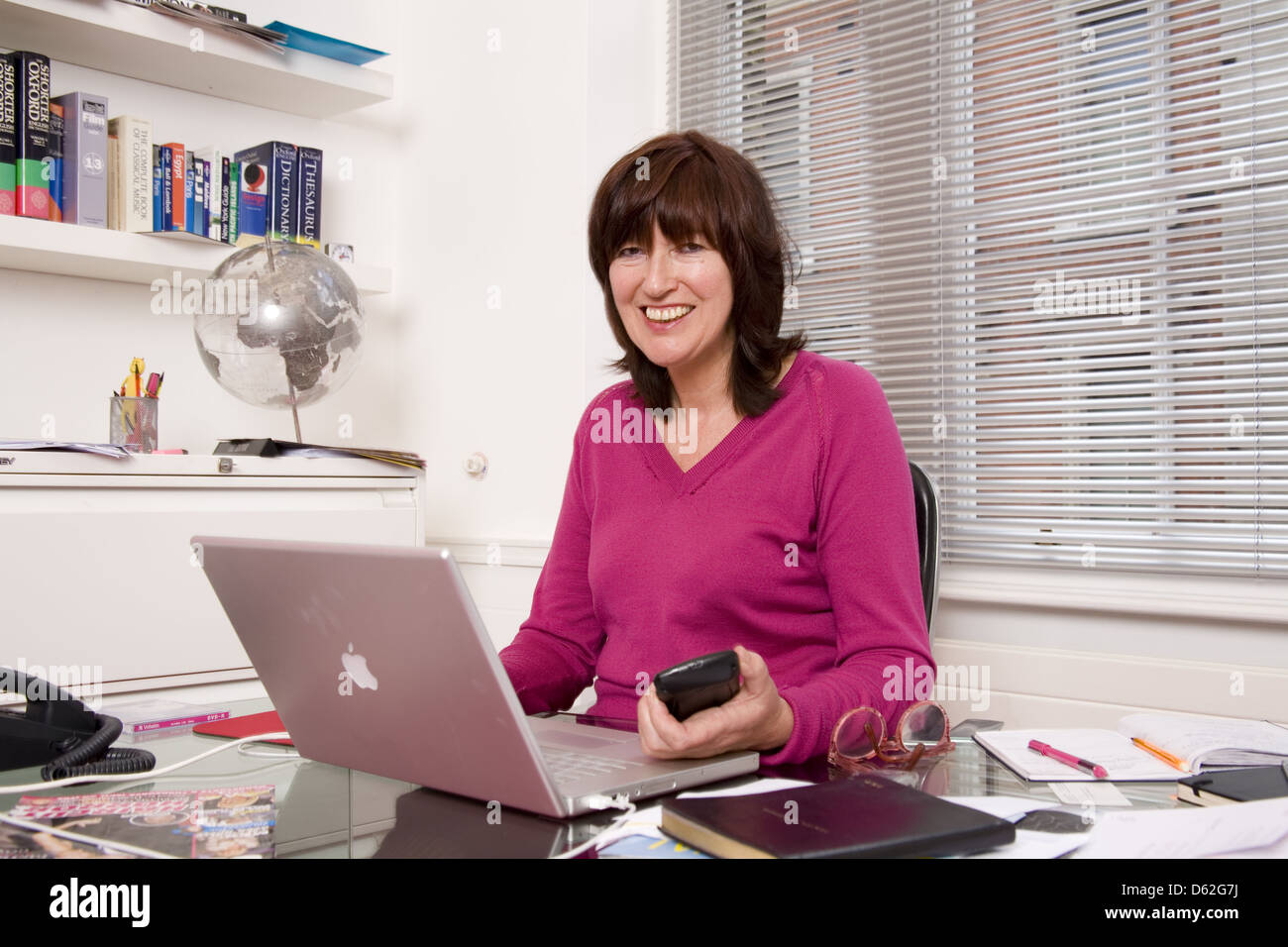 Janet Street-Porter, English media personality, journalist and broadcaster at the office for the deadline TV series,London. - Stock Image