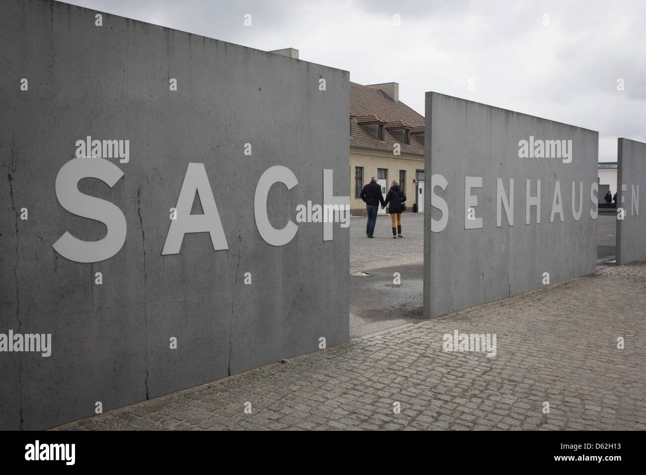 A Tourist Couple Enter The Sachsenhausen Memorial And Museum Stock