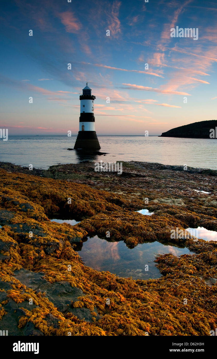 Dawn at Penmon Lighthouse, Anglesey West Wales UK Stock Photo