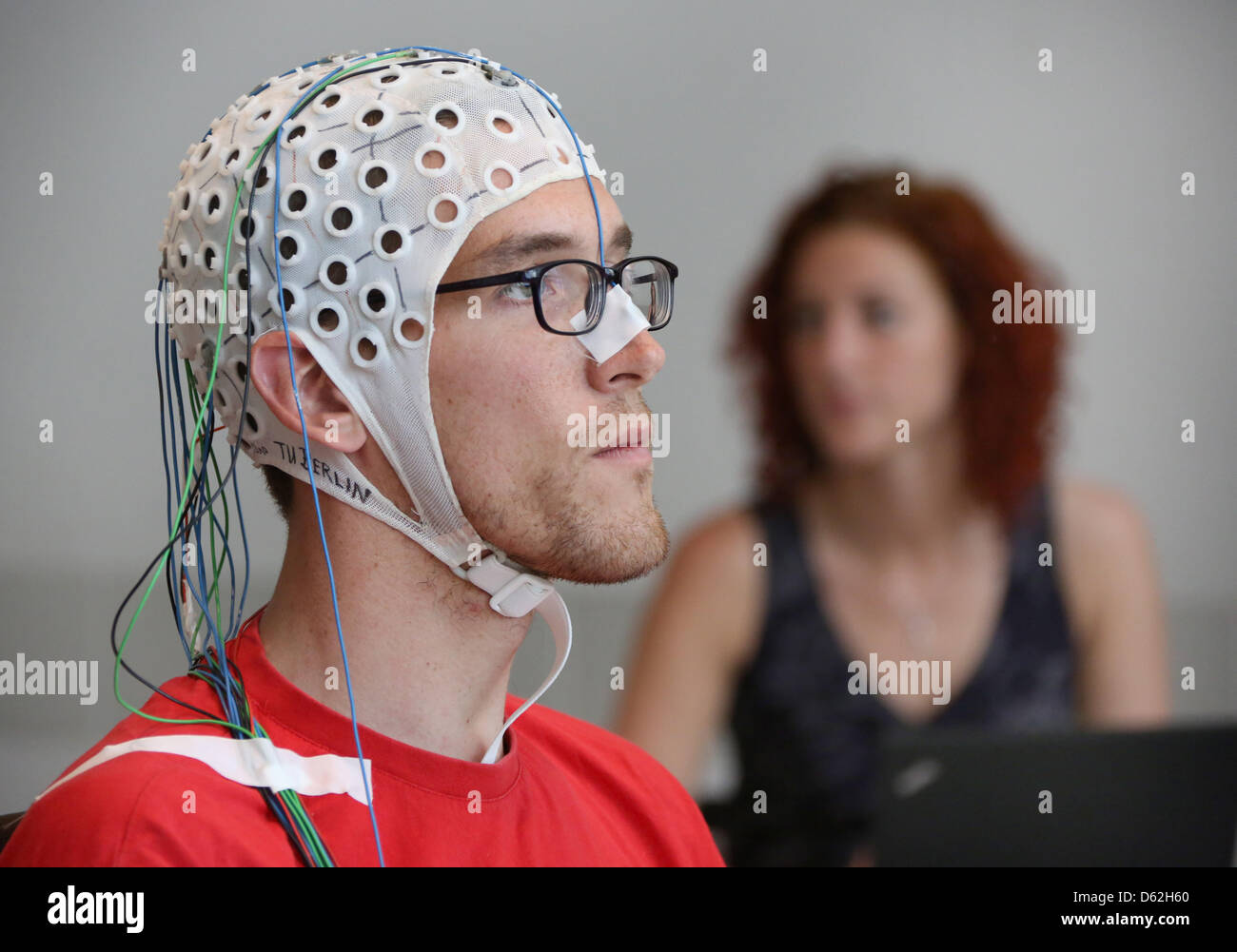 Sven Daehne plays chess with an EEG cap (Electroencephalogram) at the Technical University in Berlin,Germany, - Stock Image