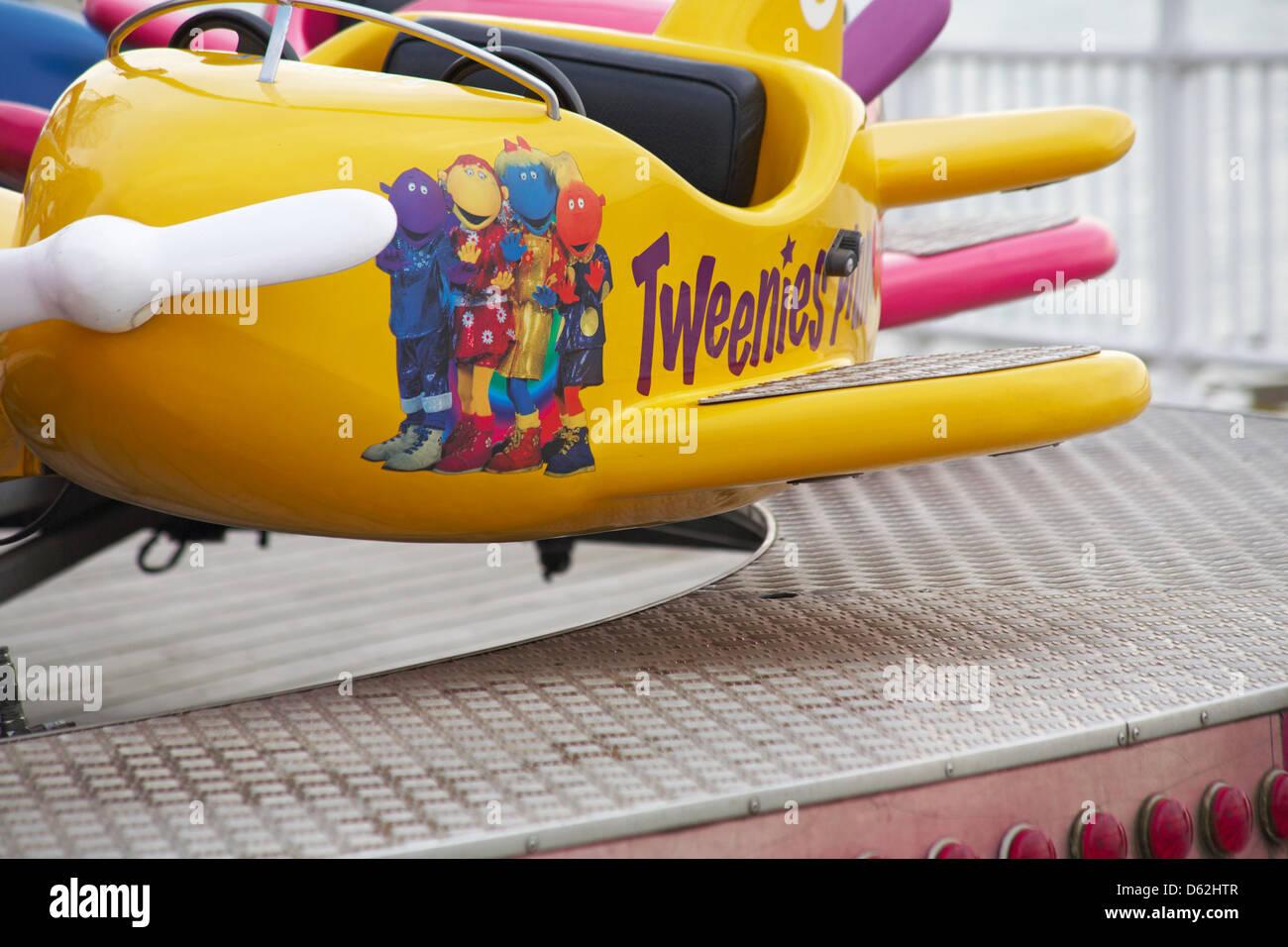 Tweenies fairground ride on Bournemouth Pier in March - Stock Image