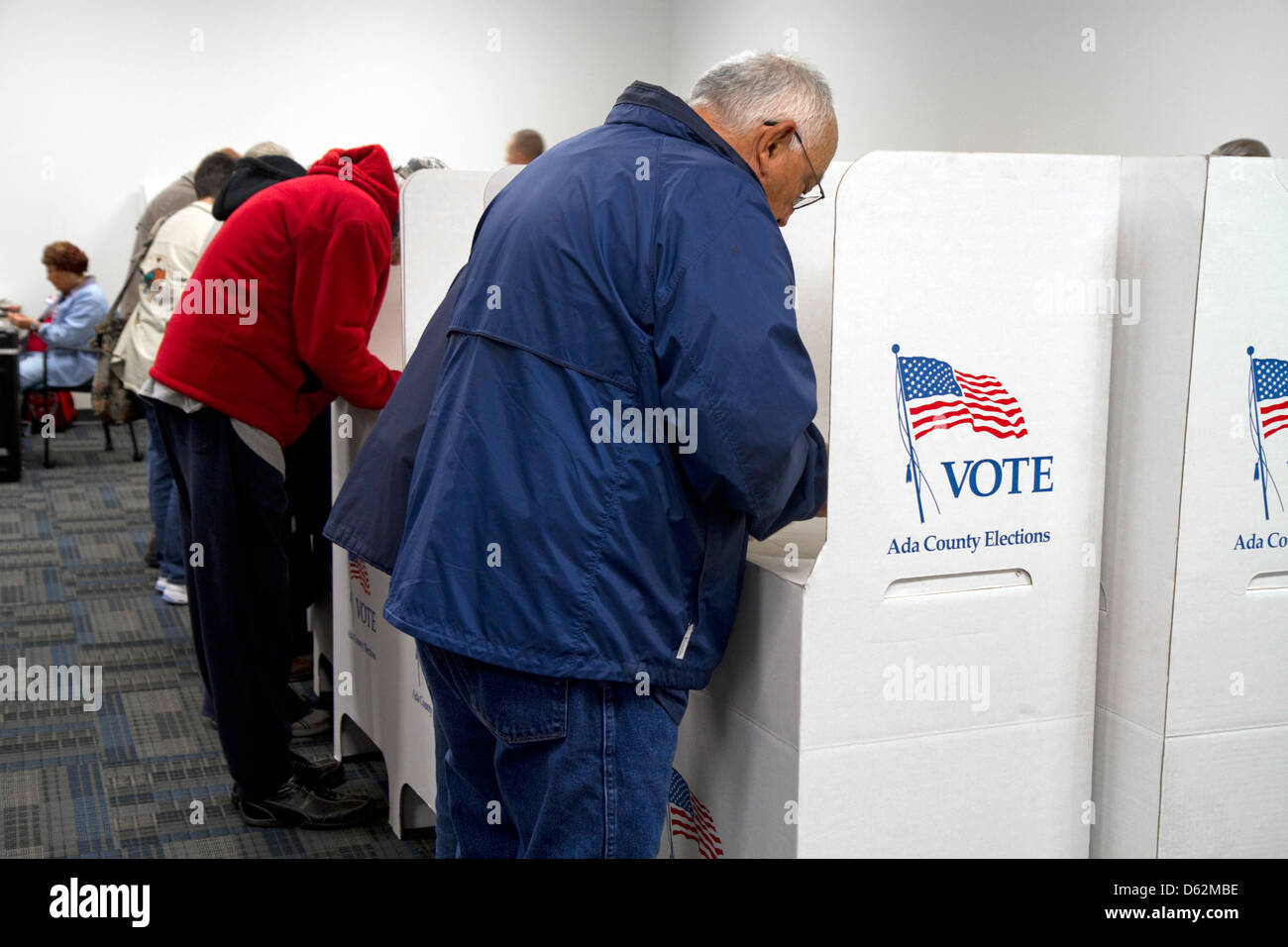 People vote in cardboard voting booths at a polling station in Boise, Idaho, USA. - Stock Image
