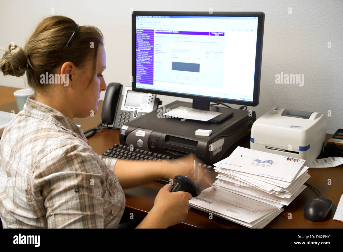 Election worker recording absentee ballots in Boise, Idaho, USA. - Stock Image