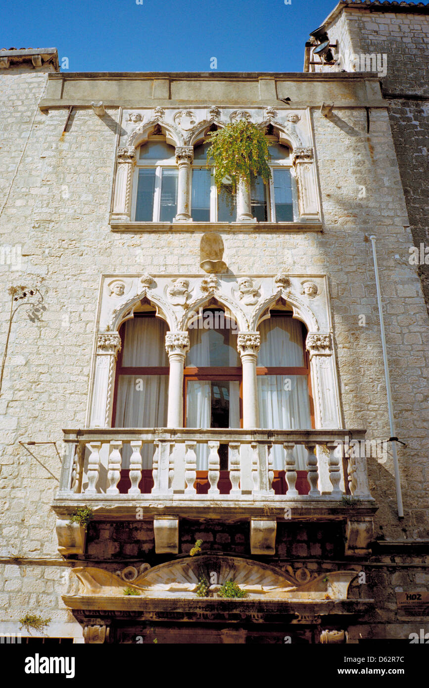 The mediaeval town of Trogir Croatia is full of old Venetian palaces,  now used as modern homes and business premises - Stock Image
