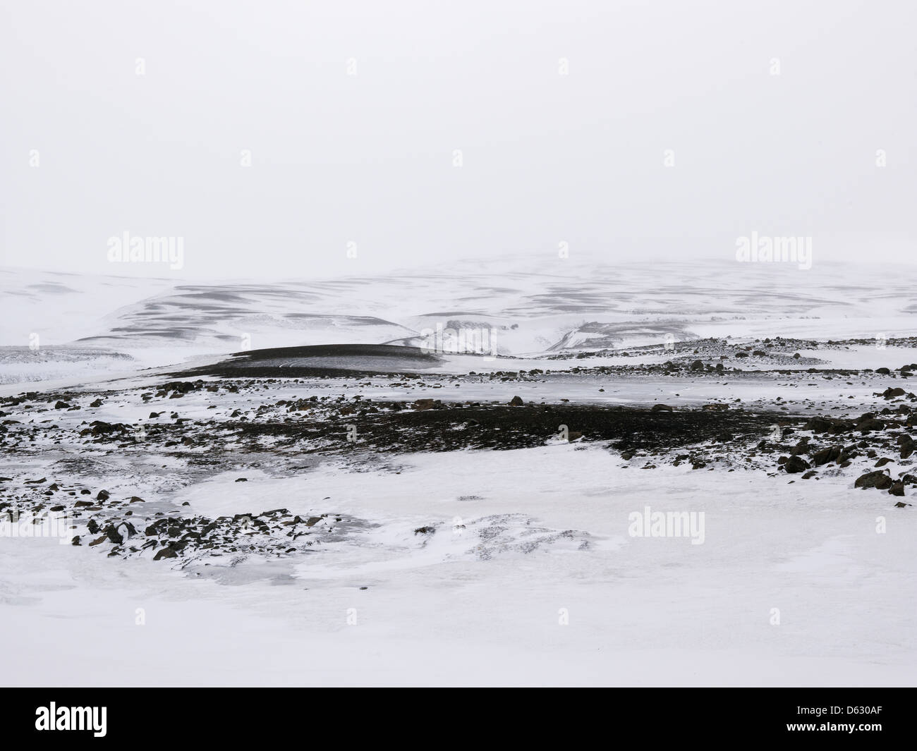 snow-covered lava fields and mountain hills on Northern Iceland - Stock Image