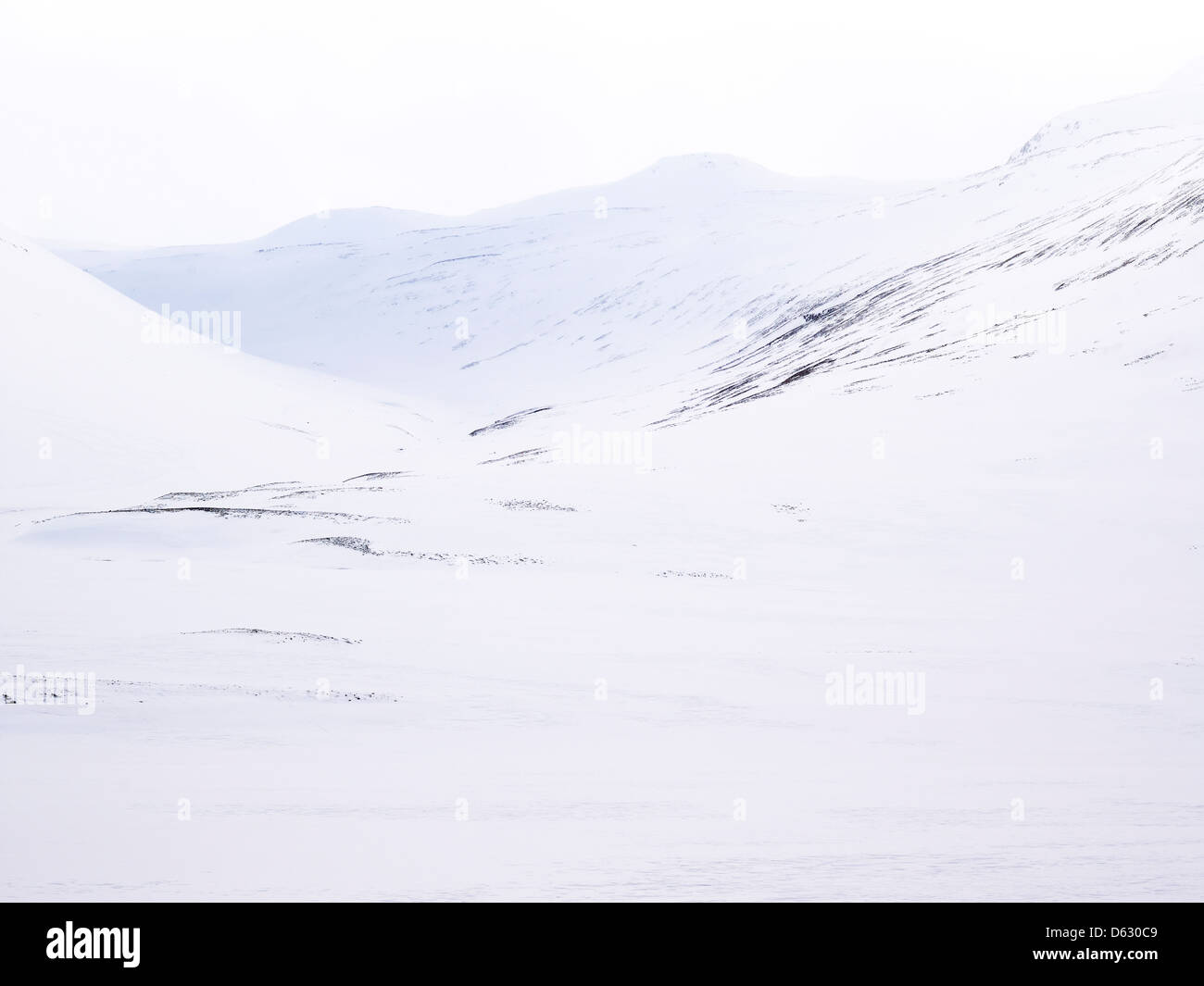 snow-covered lava fields on the  mountain hills of Northern Iceland - Stock Image