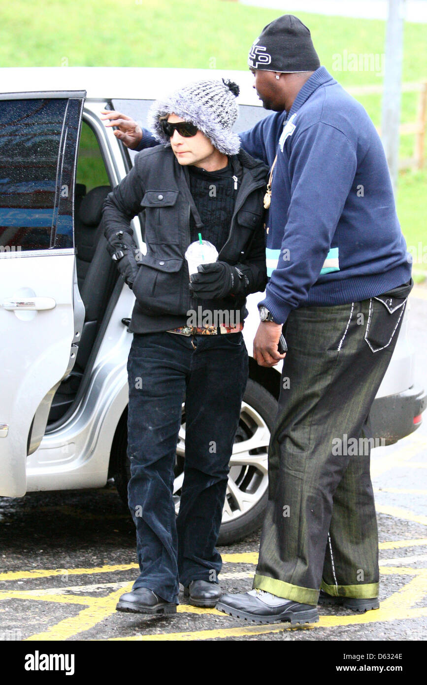 Corey Feldman is accompanied by a large security guard as he arrives at Dancing on Ice rehearsals an hour after - Stock Image