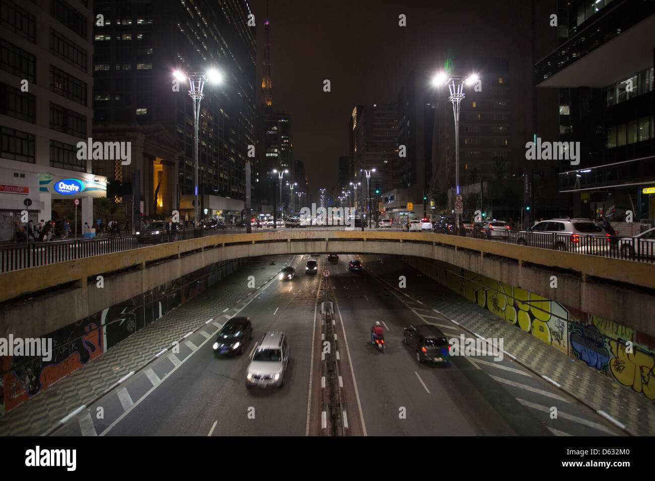 View of an overpass through Paulista Avenue at night in Sao Paulo.   Paulista Avenue is home to some of the world's - Stock Image