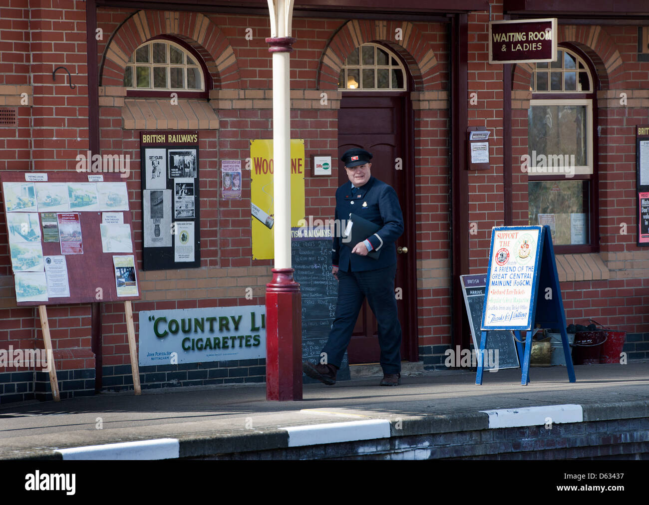The station master walks along the station platform at Leicester North Station, Leicester; The Great Central Railway. - Stock Image