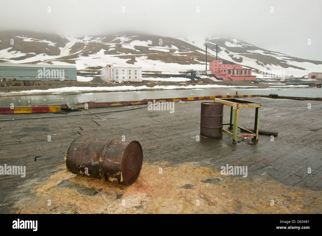 The harbor at the abandoned Russian society Pyramiden, at Spitsbergen, Svalbard region, Norway. - Stock Image
