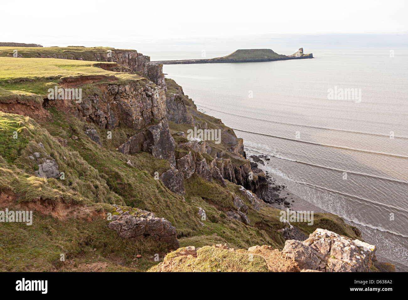 Sea cliffs and Worm's Head, Gower, Wales, UK - Stock Image