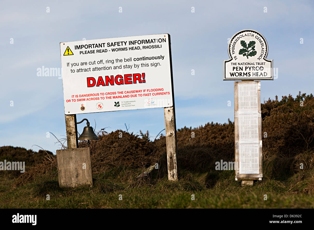 Danger sign for being cut off at high tide on Worm's Head, Rhossili, Gower, Wales, UK - Stock Image