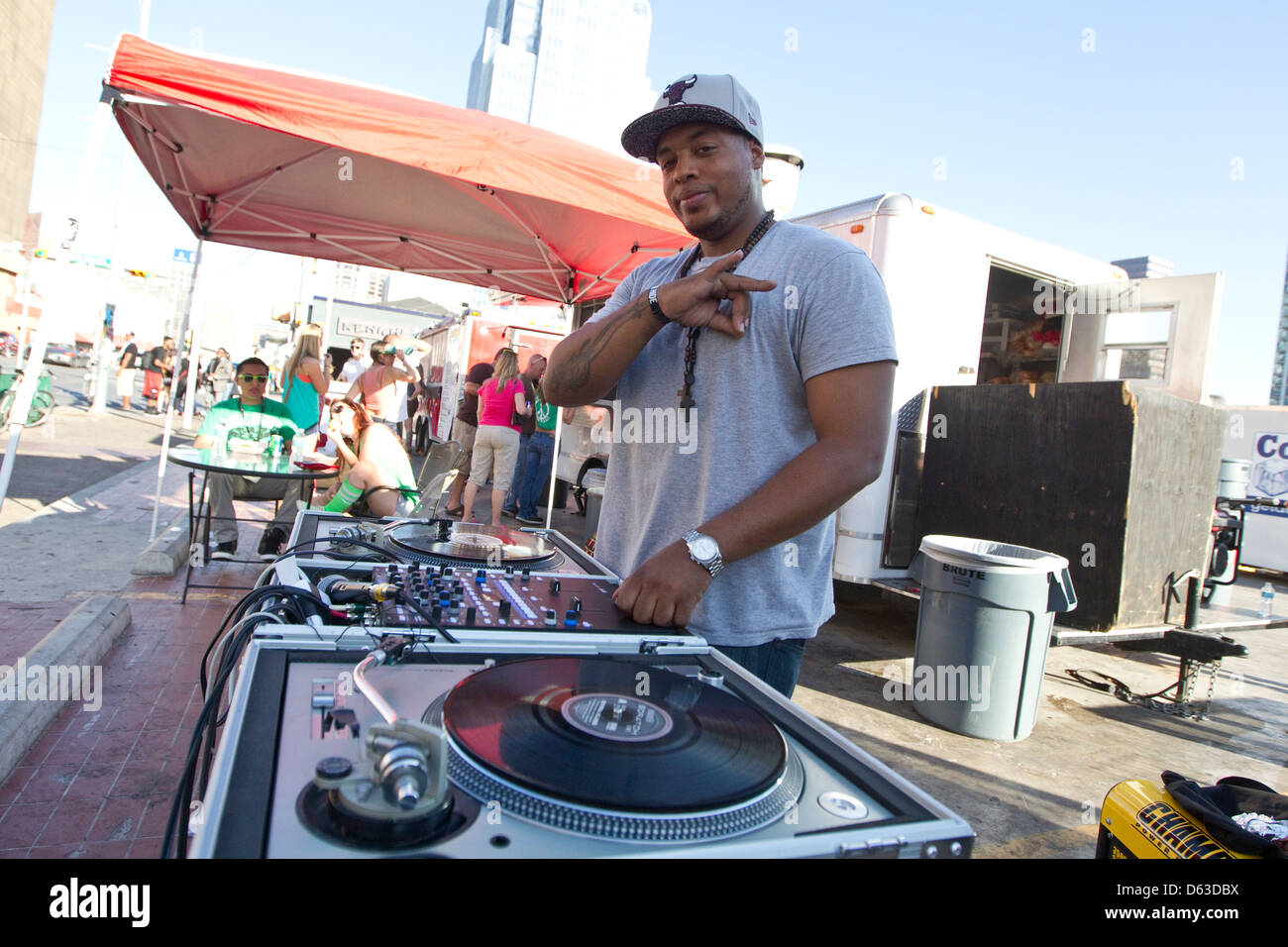 African-American DJ spins records and shows off his tattoo during the SXSW musical festival in Austin, Texas - Stock Image