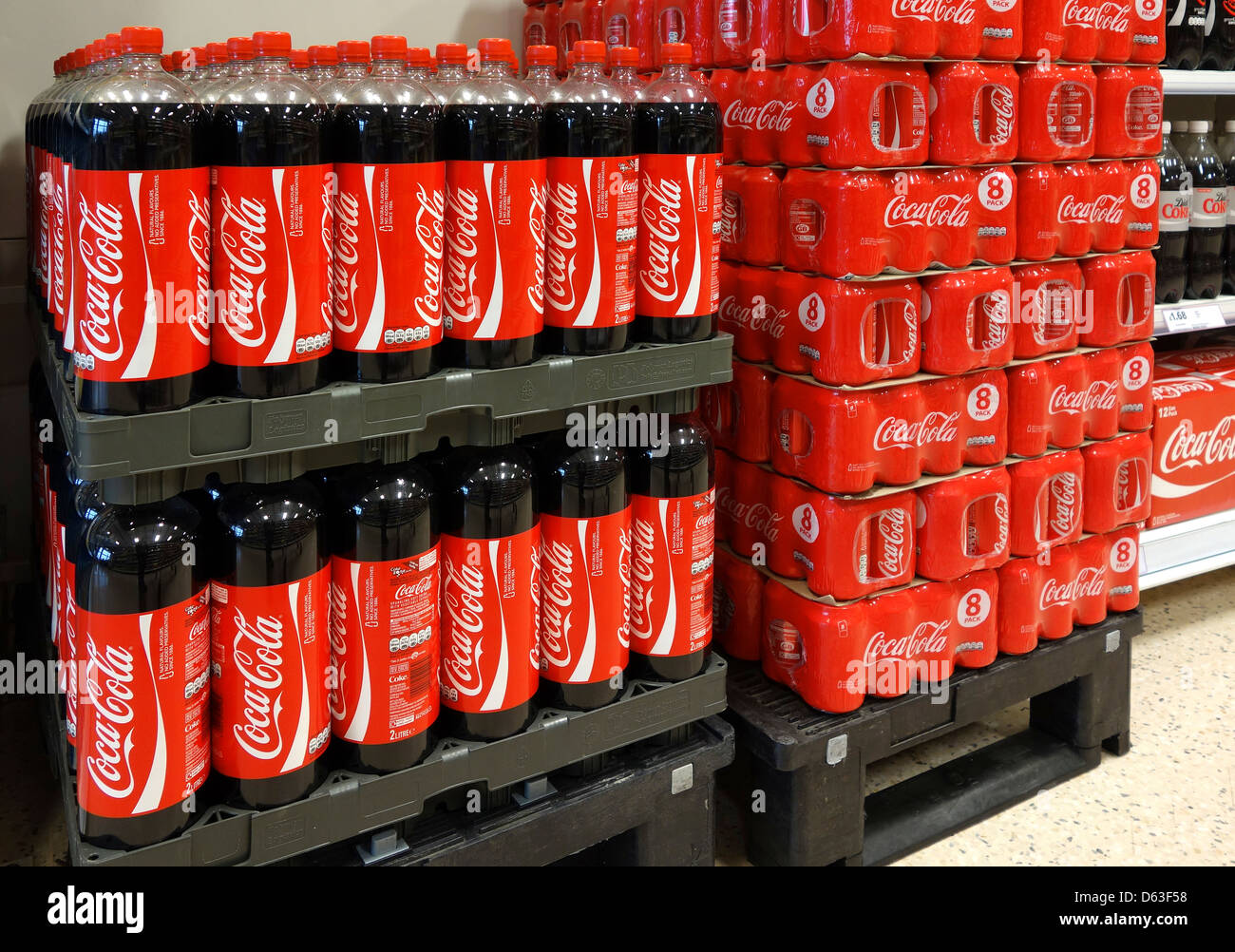 Bottles and cans of Coca-Cola in a supermarket - Stock Image
