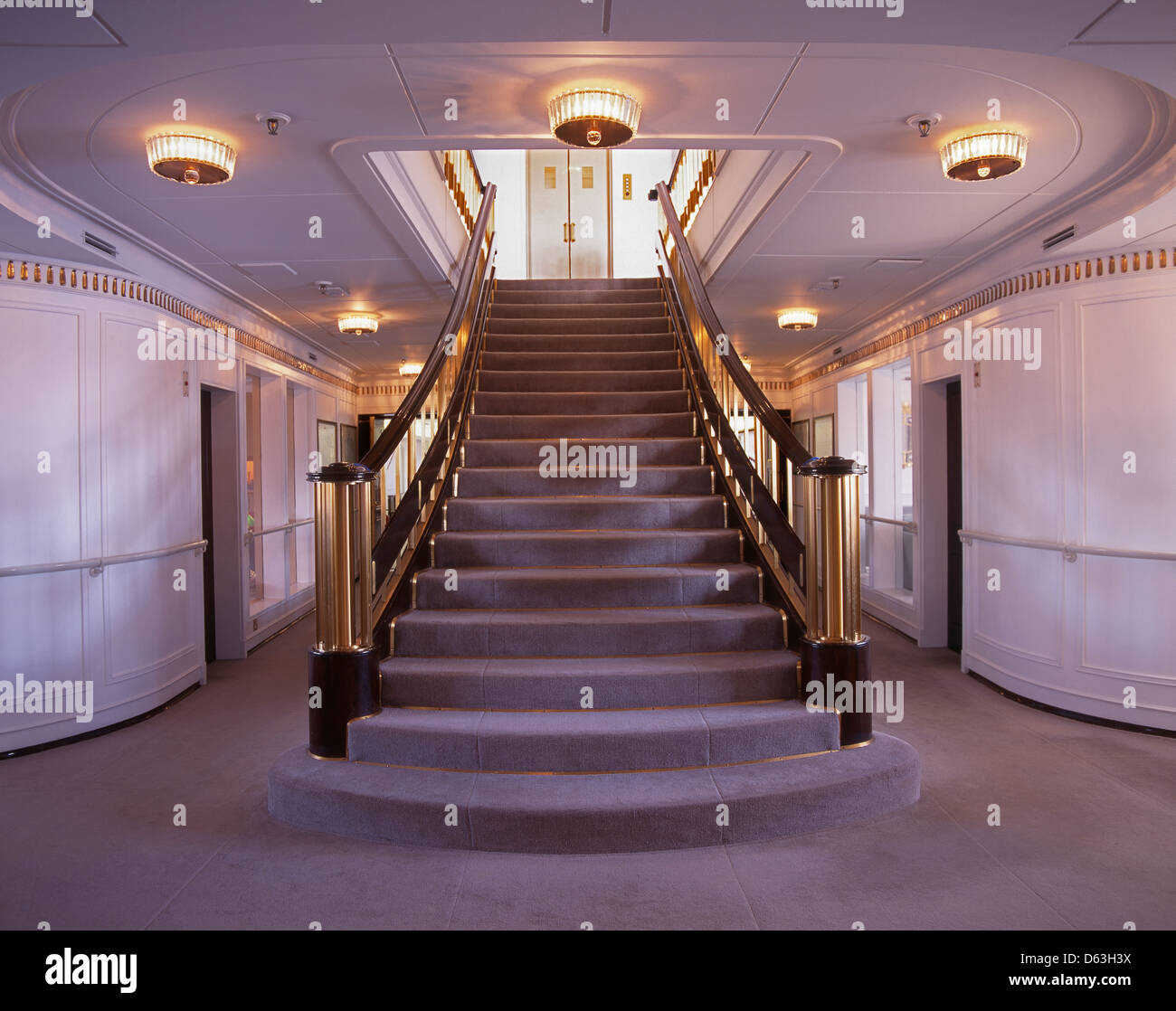 The staircase on the Royal Yacht Britannia, moored at Ocean Terminal in Leith, Edinburgh, and now a visitor attraction. - Stock Image