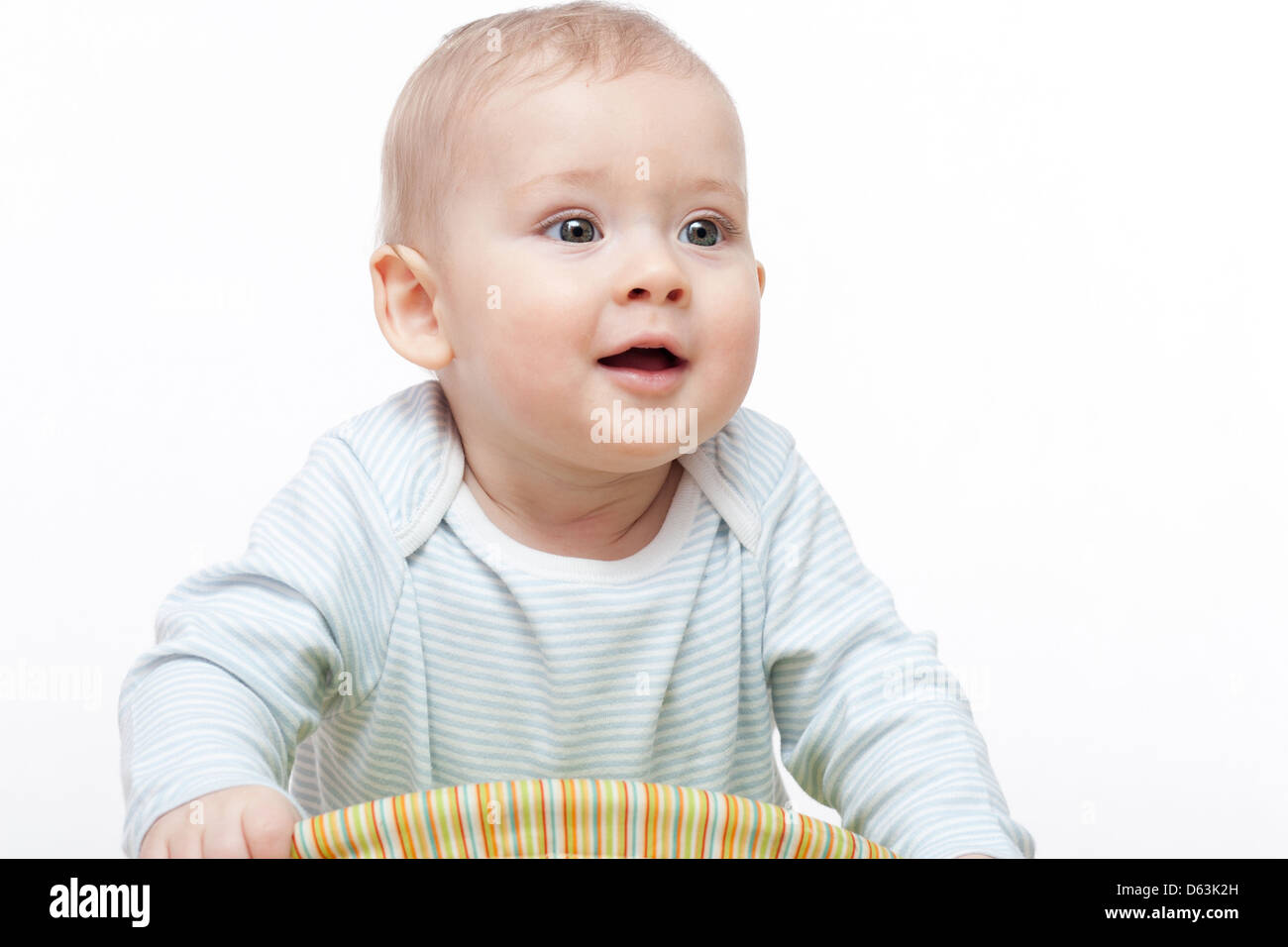 Beautiful 9 months old baby boy smiling - Stock Image