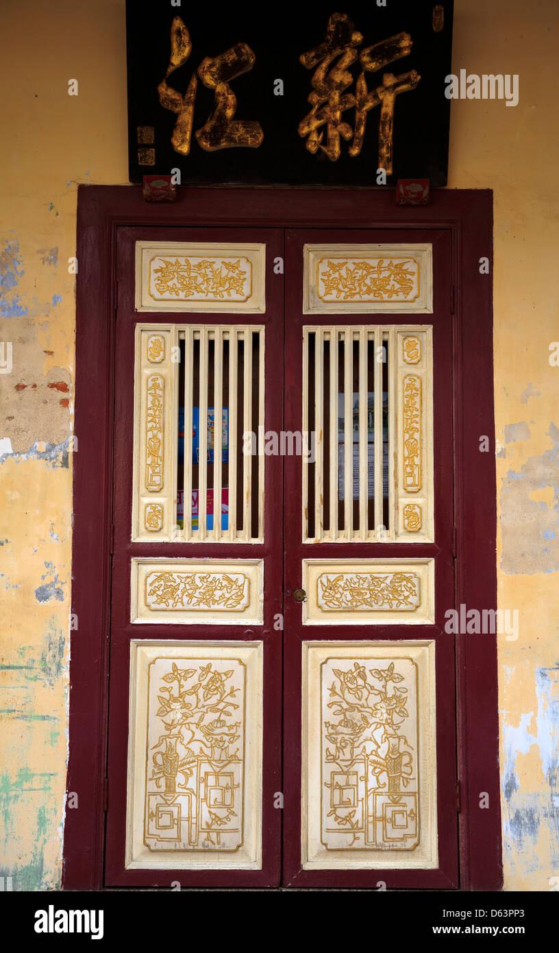 A door with a decorative pattern at Leong San Tong Khoo Kongsi clan house, George Town, Penang, Malaysia - Stock Image