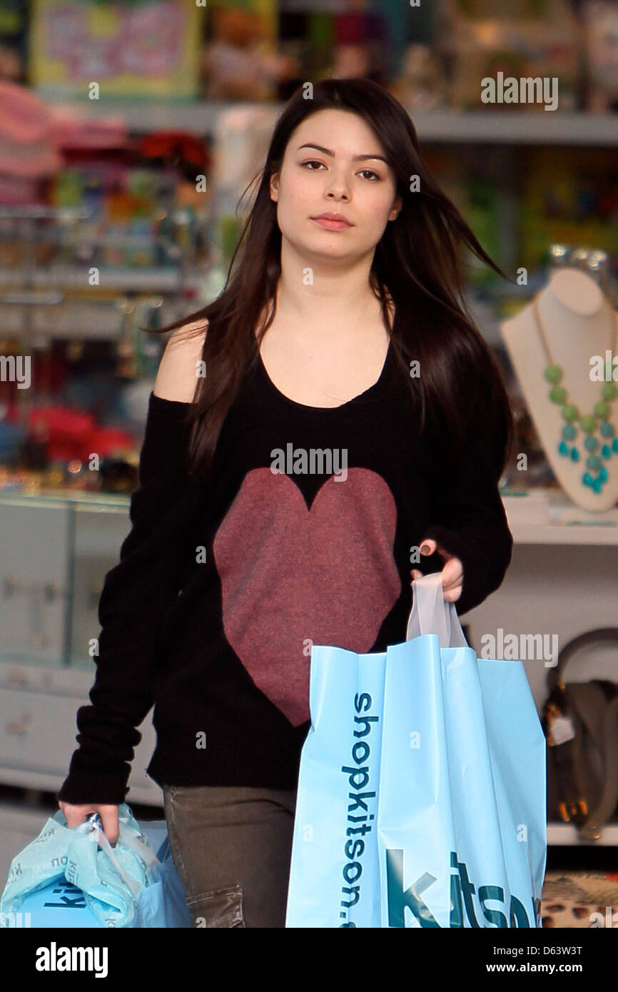 Miranda Cosgrove departs Kitson on Melrose Avenue with two large shopping bags Los Angeles, California - 25.03.11 - Stock Image