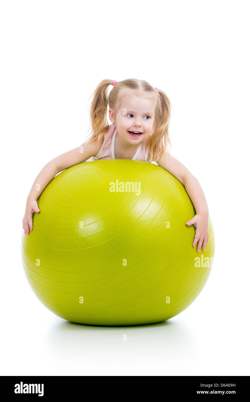 Child having fun with gymnastic ball isolated - Stock Image