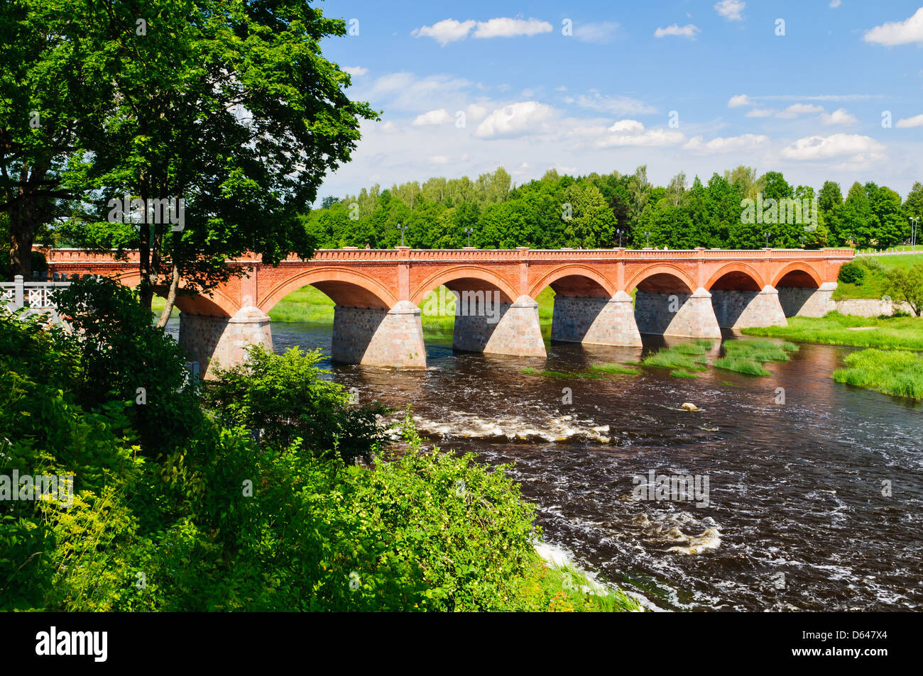 brick bridge over venta river in kuldiga, latvia - Stock Image