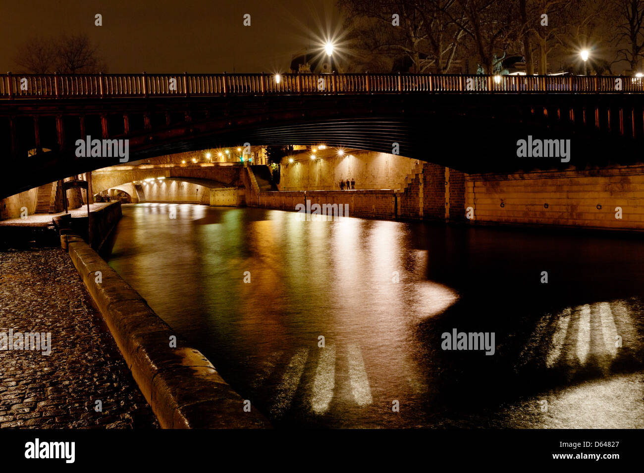 pont au Double and Seine river in Paris at night - Stock Image