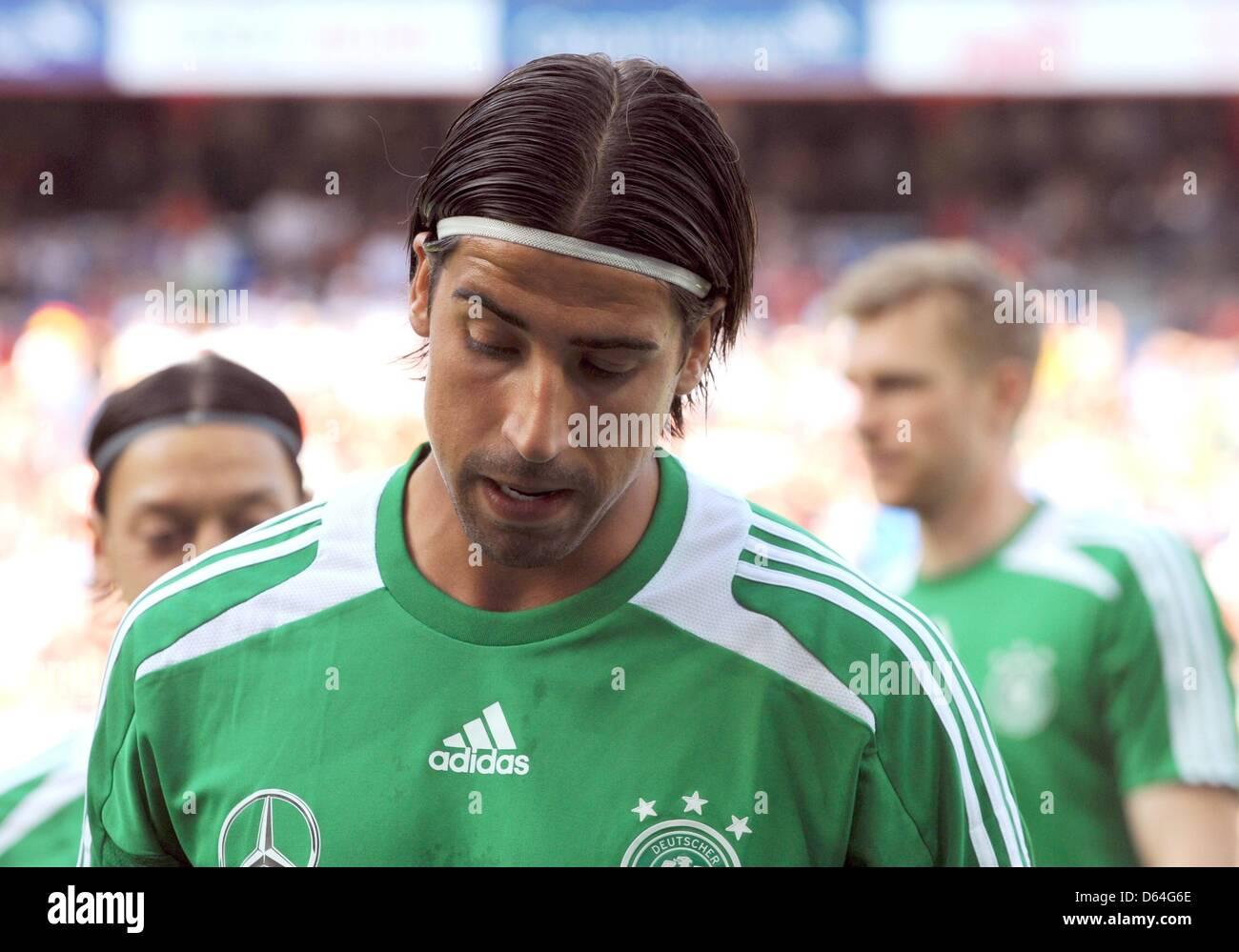 Per Mertesacker Sami Khedira Mesut Stock Photos   Per Mertesacker ... 71d12feb0bec4