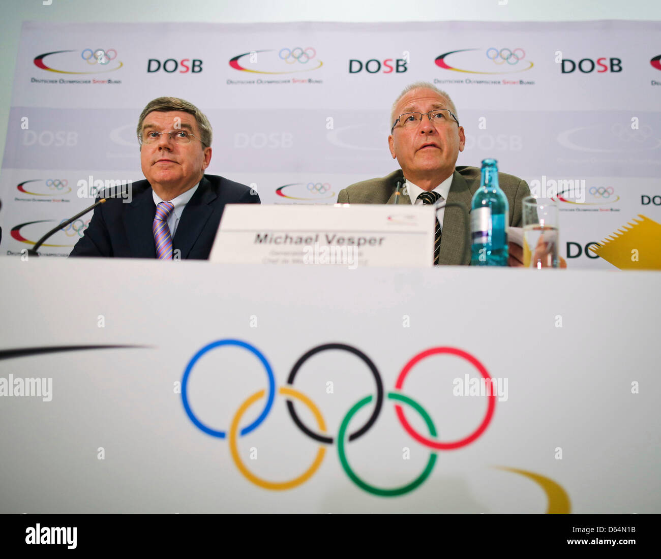 President of the German Olympic Sports Confederation (DOSB) Thomas Bach (L) and Director General of the DOSB Michael - Stock Image