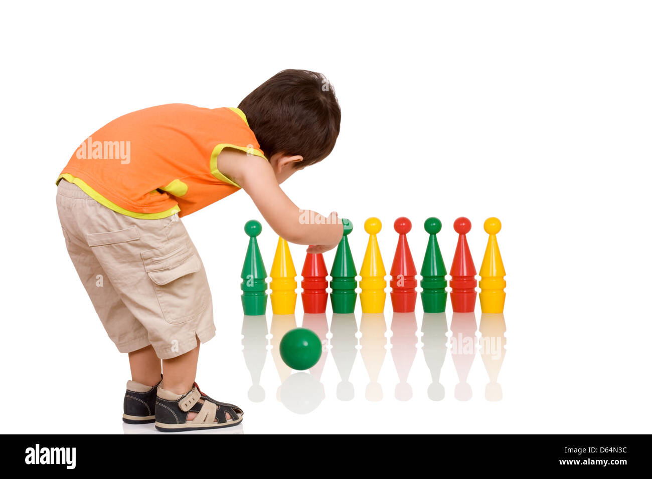The little boy is played children's bowling - Stock Image