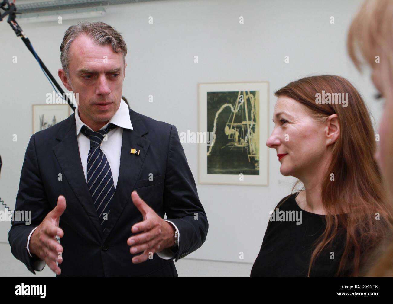 German artist Neo Rauch and his wife Rosa Loy (R) walk through the exhibition 'Neo Rauch. Das grafische Werk - Erster Stock Photo