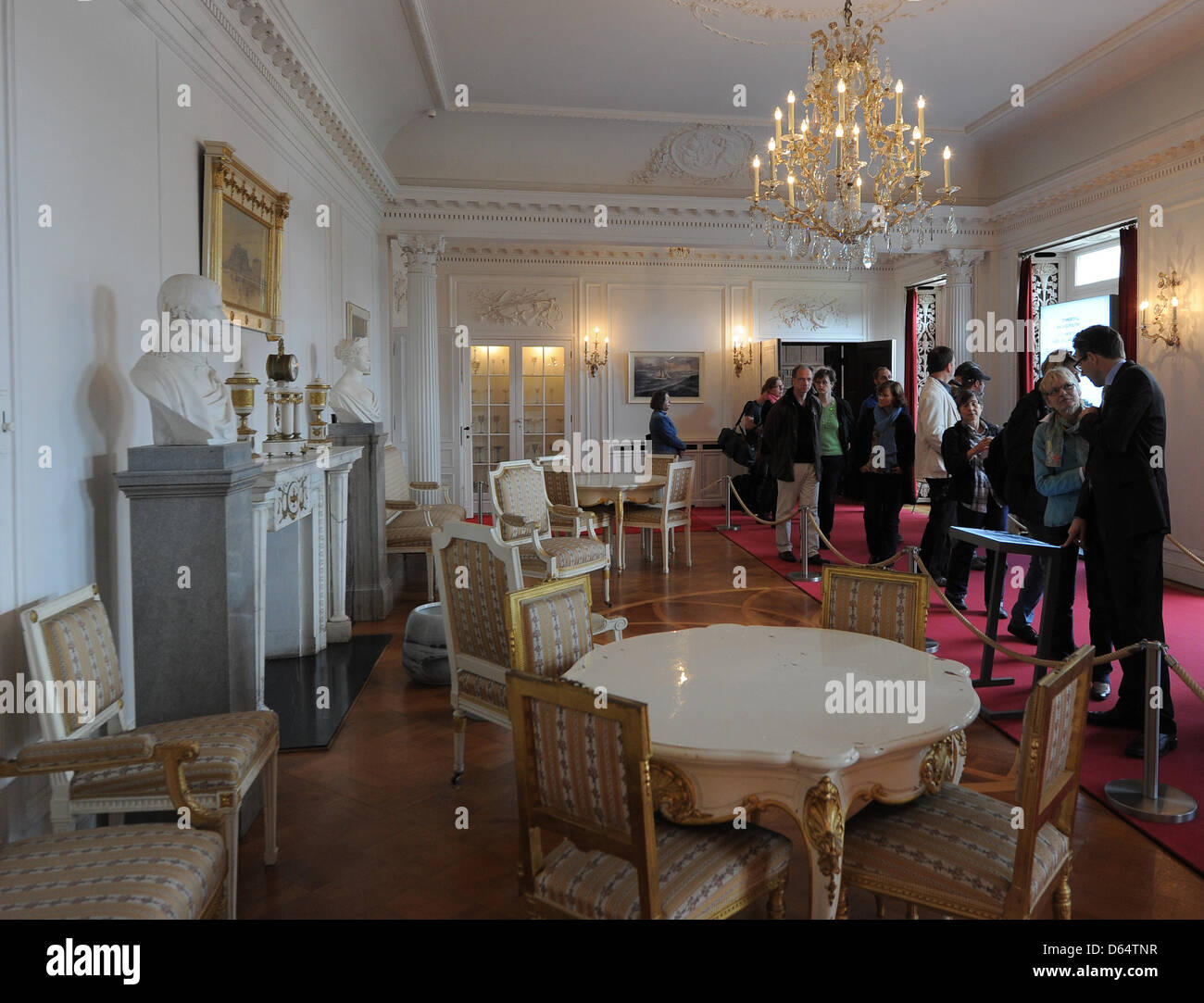 Journalists view exhibits of the permanent exposition on the 1945 Potsdam Conference at Cecilienhof Palace in Potsdam, Germany, - Stock Image