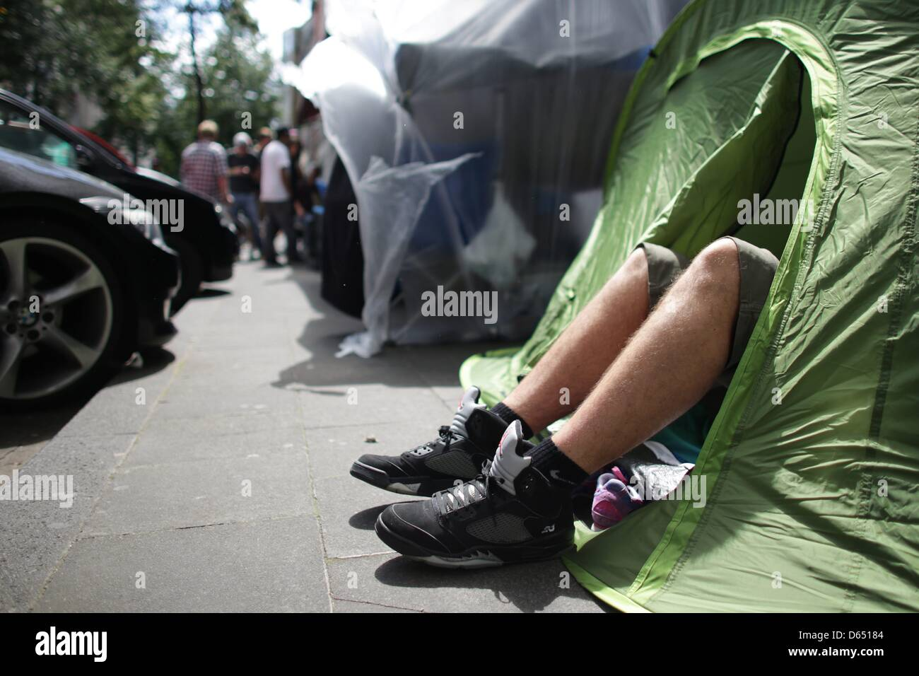 Fans camp outside of 'The Good Will Out' sneaker store in Cologne, Germany, 08 June 2012. American rapper - Stock Image