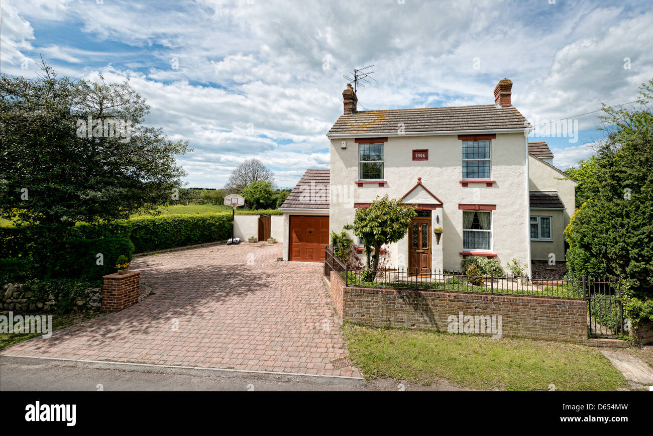 An English cottage set in its own grounds - Stock Image