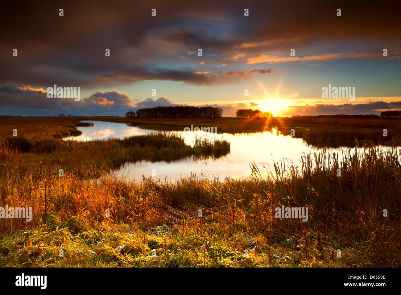 dramatic sunrise over lake - Stock Image