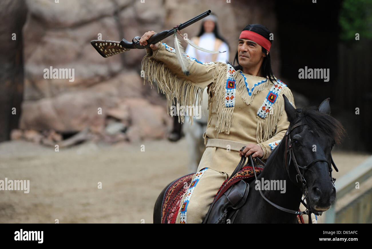 Actor Erol Sander as Winnetou (C) gives an interview after a photo rehearsal 'Winnetou II' at the Karl - Stock Image