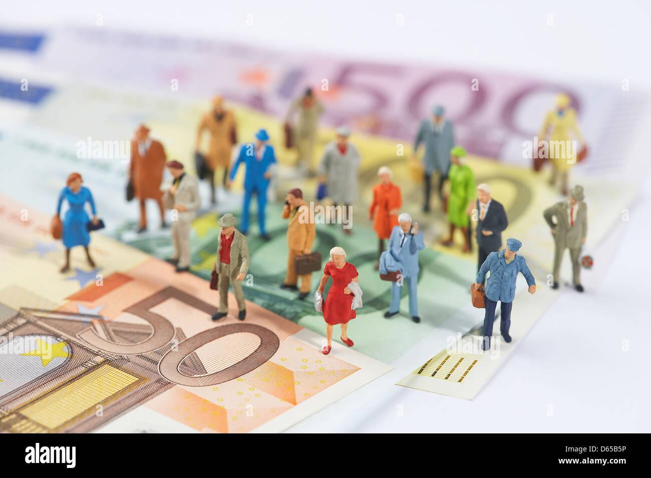 figurine,banknote,business world - Stock Image