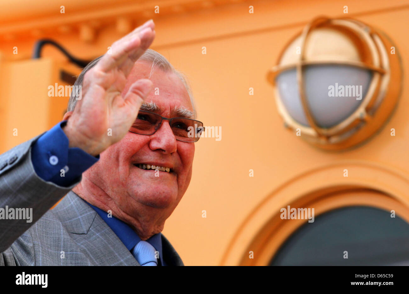Henrik, Prince Consort of Denmark, waves from aboard the royal yacht 'Dannebrog' during his visit to Wismar - Stock Image