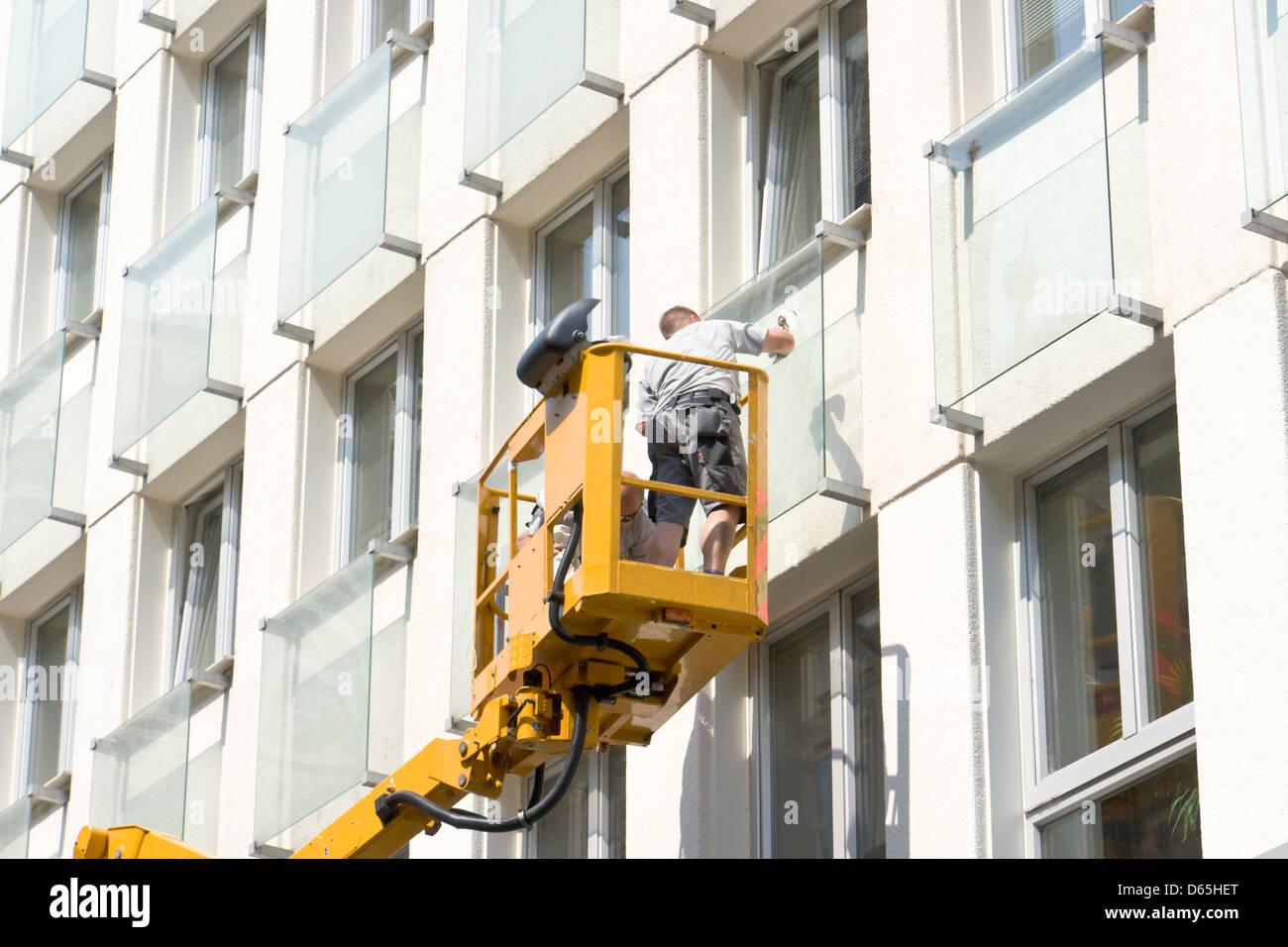 Window cleaner on aerial platform - Stock Image