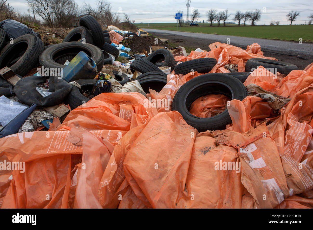 Illegal dumping of used tires discarded at county road, Czech Republic - Stock Image