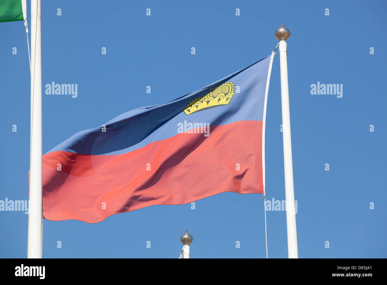 The flag of Liechtenstein fluttering in the breeze. - Stock Image