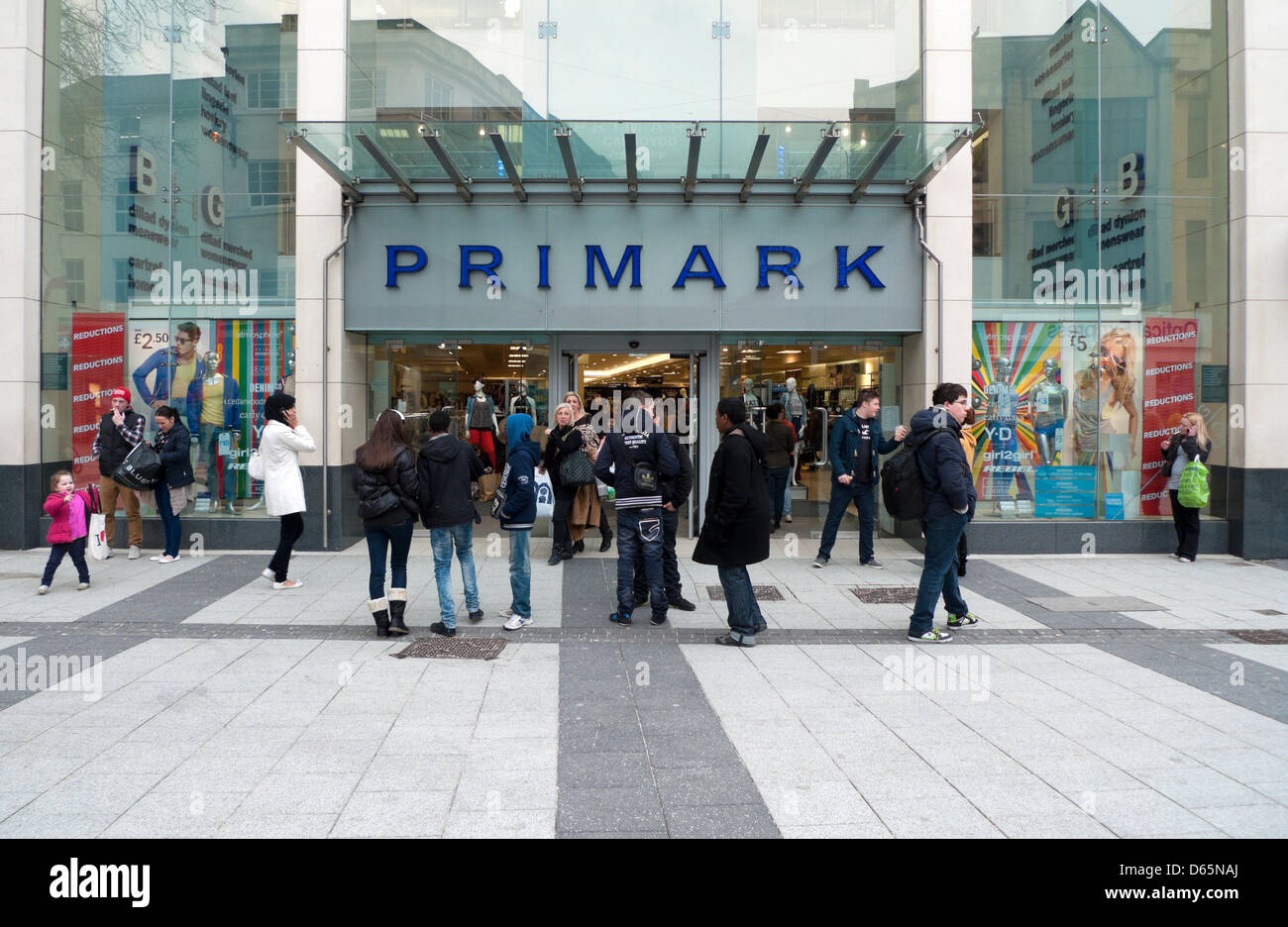 People outside the exterior view of the Primark store front storefront in Queen Street Cardiff Wales UK  KATHY DEWITT - Stock Image