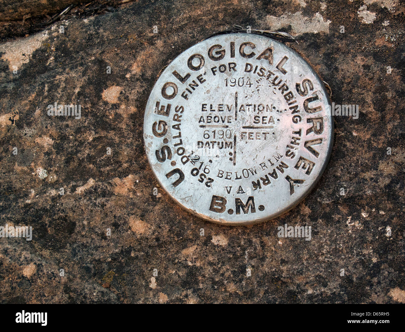 Grand Canyon National Park, Arizona - A U.S. Geological Survey bench mark 1216 feet below the south rim on the Grandview - Stock Image