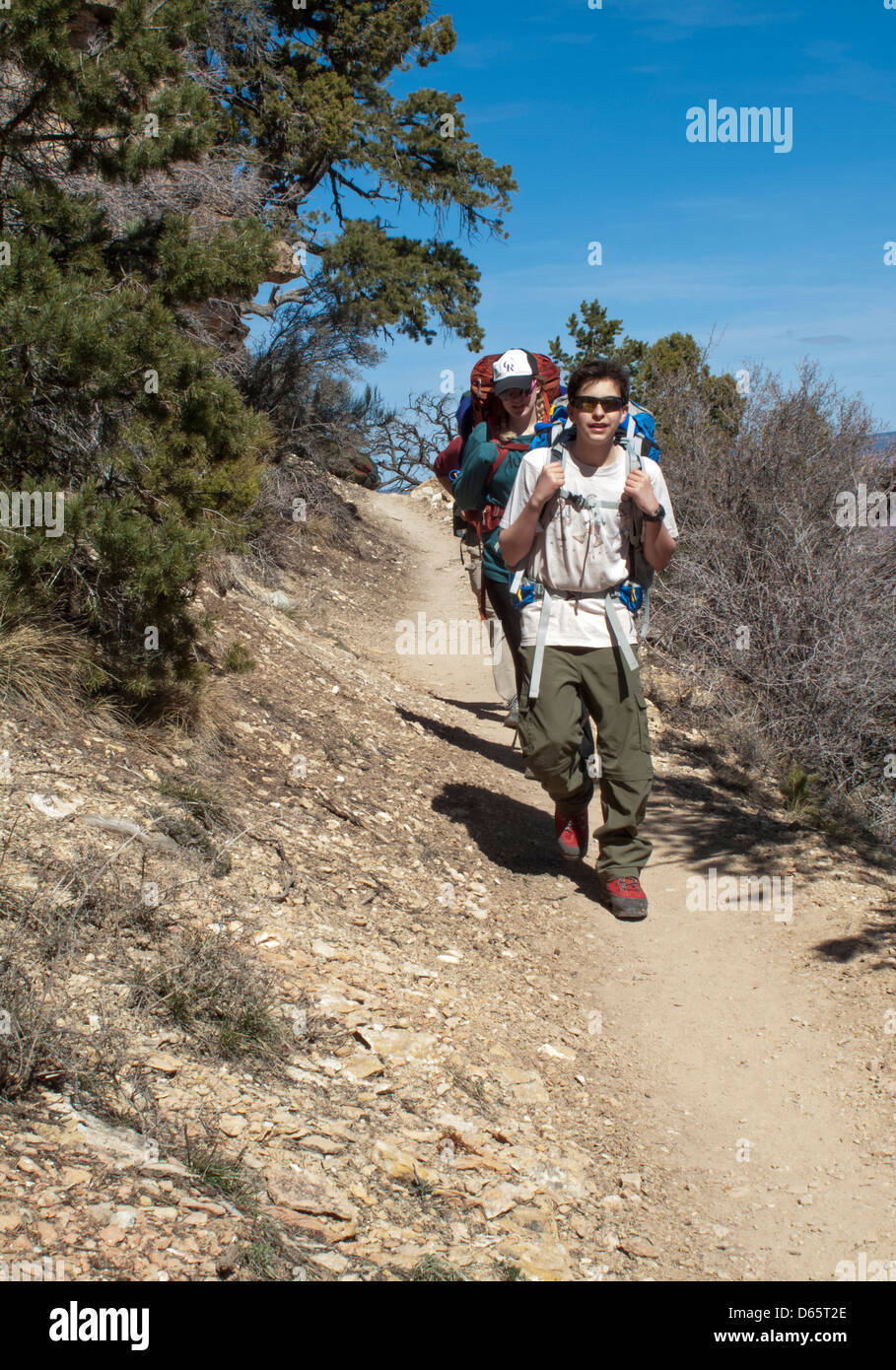 Grand Canyon National Park, Arizona - Joey West, 14, hikes on the Grandview Trail with his cousin, Mariel West, - Stock Image