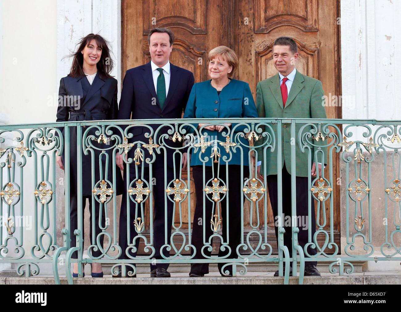 Schloss Meseberg, Germany. April 12, 2013. German Chancellor Angela Merkel and her husband Joachim Sauer (R) welcome - Stock Image