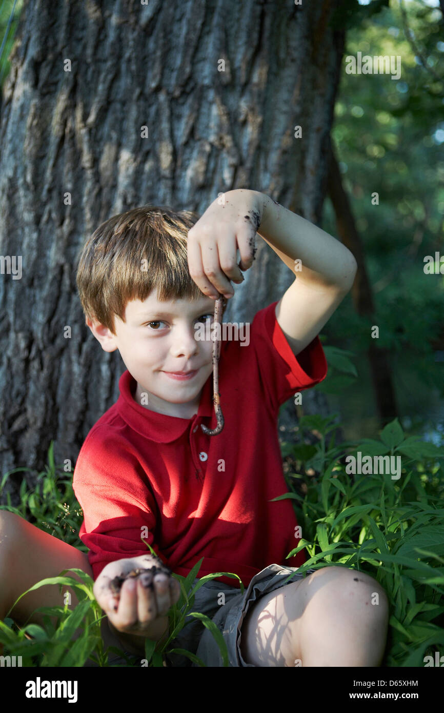 9 year old boy with worm - Stock Image