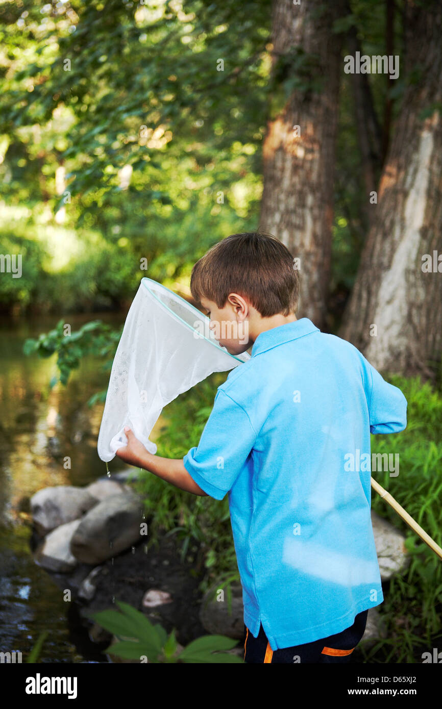 6 year old boy with fishing net - Stock Image