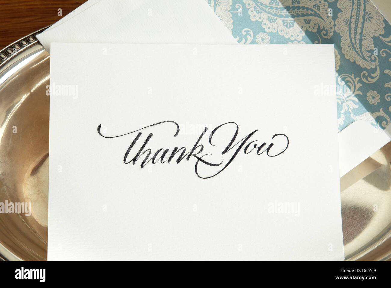 Thank you note on silver tray. - Stock Image