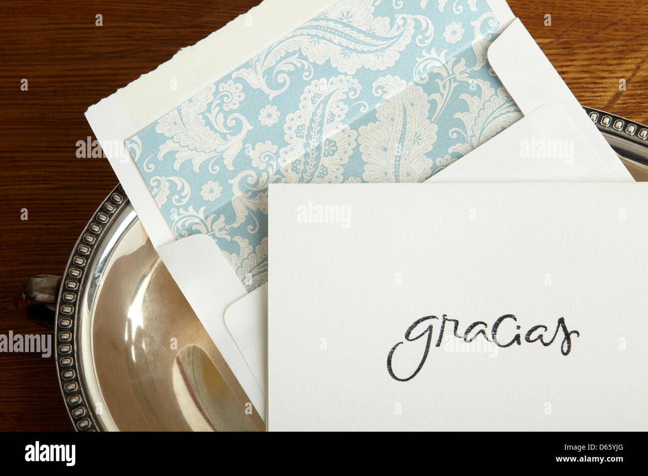 Gracias, thank you note on silver tray. - Stock Image