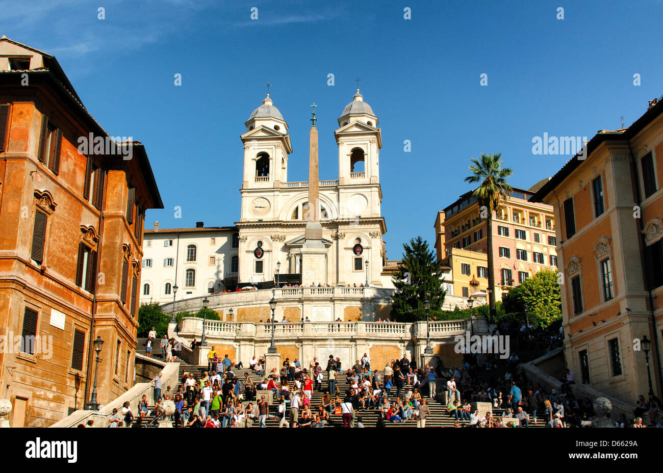 Tourists at the Spanish Steps leading to Trinita dei Monti Church at the top. Rome, Italy - Stock Image