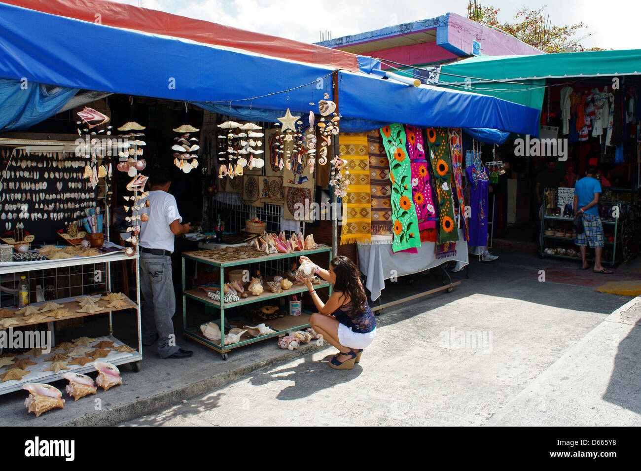 Young Woman Tourist Looking At Seashells Mexican Handicrafts In